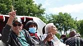 From left, Hughes Van Ellis, 100; Lessie Benningfield Randle, 106; and Viola Fletcher, 107, the oldest living survivor of the Tulsa Race Massacre and older sister of Mr. Van Ellis, attend the Black Wall Street Legacy Festival on May 28 in Tulsa, Okla.