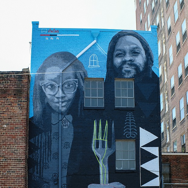 """Cityscape: Slices of life and scenes in Richmond/The mural """"African American Gothic"""" is a modern take on Grant Woods' classic 1930 painting titled """"American Gothic"""" that depicts an elderly farming couple with the man holding a pitchfork. This version, created by artists Andre Shank and Sone-Seeré, can be found on a building at 404 E. Grace St. in Downtown."""