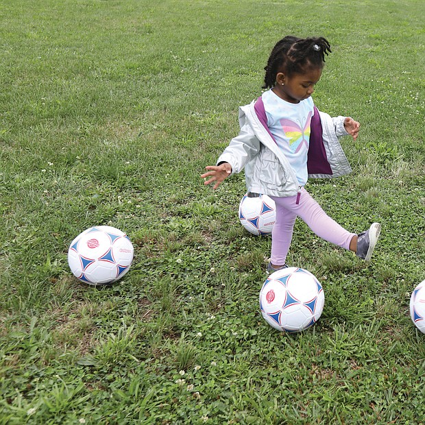Budding athlete/Tajiya Taper, 2,of Henrico County has fun trying to get the soccer balls into the goal set up last Saturday at Mt. Olivet Church in Church Hill for Operation Homebase. The youngster was attending the event with her grandparents, Nicole and Rodney Gore with the Team Loaded Foundation.