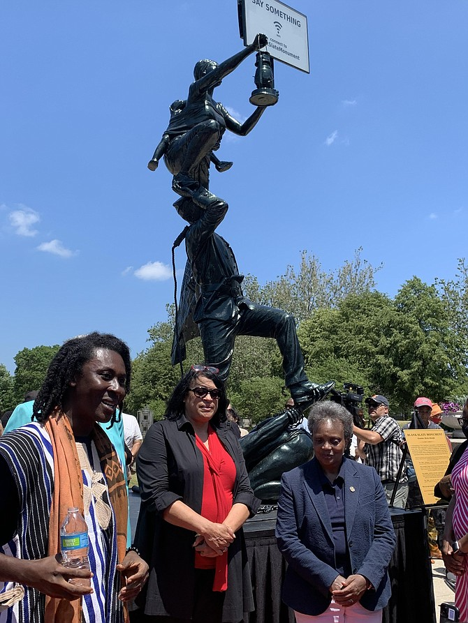 Kwame Akoto-Bamfo, an artist from Ghana, unveiled his work, Blank Slate Monument, at Saturday's Juneteenth event at the DuSable Museum of African American History. Photo by Tia C. Jones