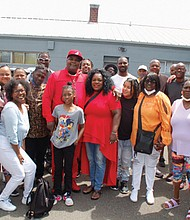 Pastor Dwight Minnieweather and his wife Cassandra, join other volunteers from their Straightway Services nonprofit, to distribute free food and supplies for people who are hungry or homeless.