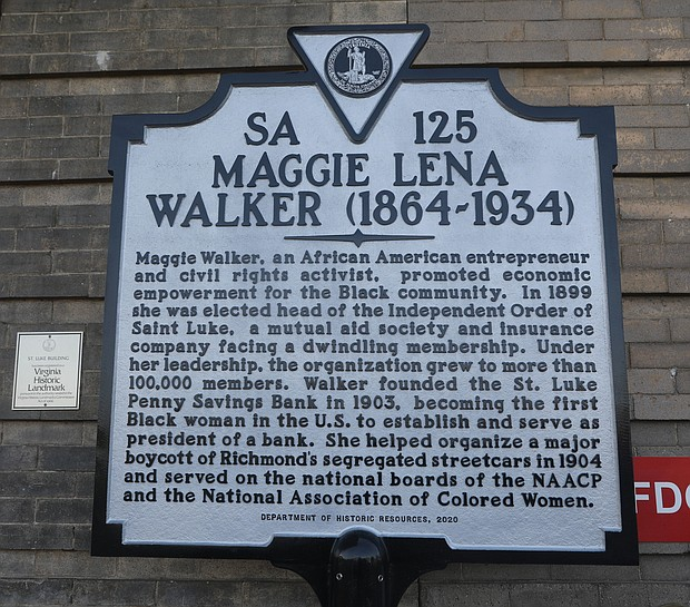 A new historic marker honoring Richmond business and civil rights leader Maggie L. Walker sits in front of the historic St. Luke Building that has stood in the 900 block of St. James Street in Gilpin Court since 1903.  Now a 12-unit apartment building with first-floor commercial space, the building began life as the national headquarters of the United Order of St. Luke, a Black fraternal and insurance group led by Mrs. Walker from 1899 until her death in 1934. Making bold moves, she pushed the fraternal order into developing the headquarters and taking other entrepreneurial action, including opening a bank.