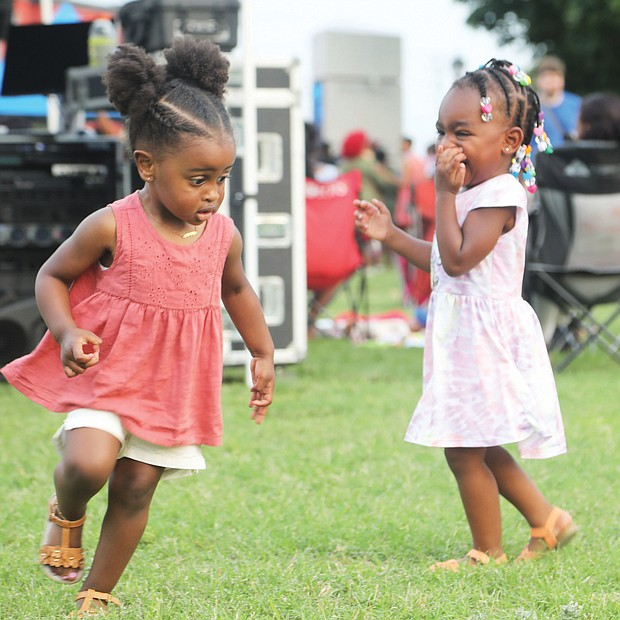 """Juneteenth fun/Gabrielle Holmes, left, and Serenity Johnson dance to the sounds of gospel at """"Juneteenth: Sounds of Freedom Celebration"""" held last Saturday evening on the lawn at Virginia Union University. The 2-year-olds were enjoying the event with family. It was one of several area commemorations of the new national holiday."""