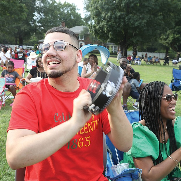 """More than 1,000 people relaxed on the lawn of Virginia Union University, enjoying the sounds of local gospel groups at """"Juneteenth: Sounds of Freedom Celebration"""" on Saturday evening. The event was sponsored by the new Hezekiah Walker Center for Gospel Music at VUU. Below, Marcus Orr of Ashland joins in with his tambourine."""