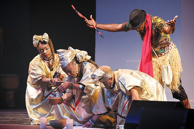 Members of the Elegba Folklore Society pour libation honoring the ancestors during a performance last Friday at Dogwood Dell in Byrd Park as part of the city's 64th Annual Festival of Arts.