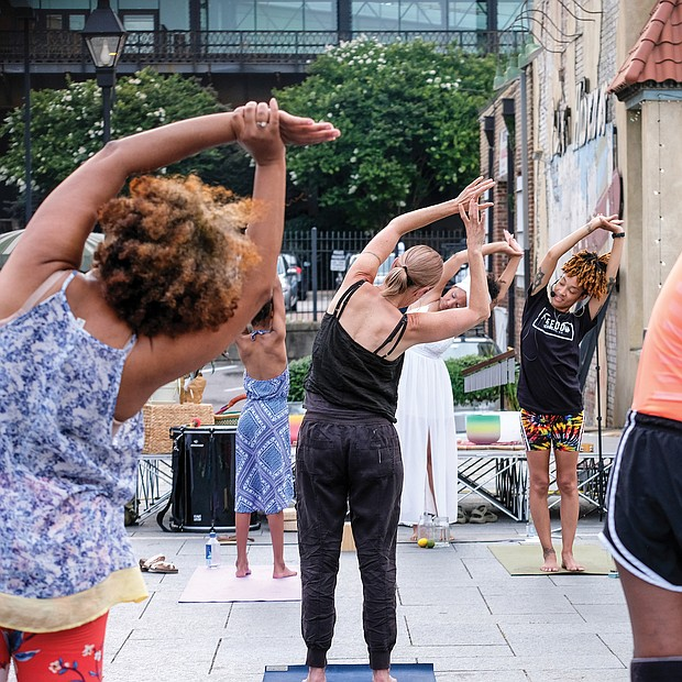 Kiran Bhagat leads a yoga class Saturday at the Juneteenth Freedom Day celebration at the 17th Street Market, featuring drumming, dancing and meditation.