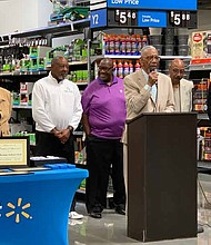 Congressman Bobby Rush during the reopening of Walmart. Rush spoke about the impact the Walmart, located at 10900 S. Doty Ave., has on the community. Photo By Tia Carol Jones