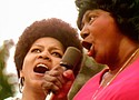 Mavis Staples and Mahalia Jackson perform at the Harlem Cultural Festival in 1969, featured in the documentary 'Summer of Soul.'   Photo courtesy Searchlight Pictures.