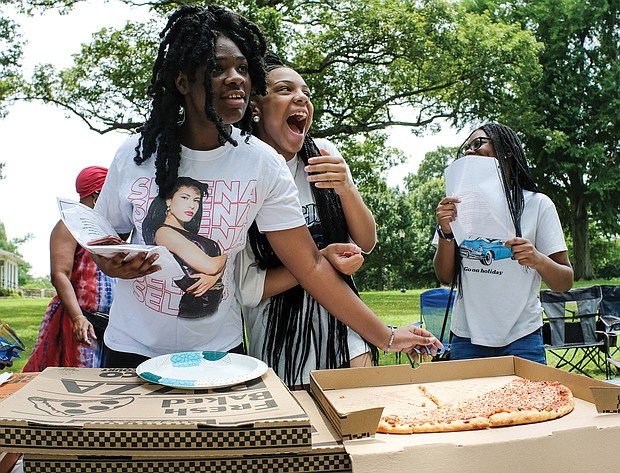 Sisterly soiree/Sisters Nylah Doswell from left, Nyaja Plummer and Nasya Doswell share a laugh and enjoy pizza during a Daughters of the King Soiree last Saturday in Byrd Park. The group meets monthly in various locations and is a ministry and mentorship program for young women sponsored by The Church of God in Richmond located in South Side.
