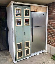 The Hyde Park Love Fridge, located near 5500 S. Woodlawn, is available to those in need of fresh fruit and vegetables, dairy and meat. Photos courtesy of University of Chicago, Office of Civic Engagement