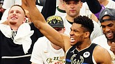 Milwaukee Bucks forward Giannis Antetokounmpo celebrates with the Bill Russell NBA Finals Most Valuable Player trophy after the Bucks claim the NBA championship Tuesday night in Game 6 against the Phoenix Suns at Fiserv Forum in Milwaukee.