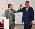 French President Emmanuel Macron, left, and the Rev. Jesse Jackson celebrate after the civil rights leader was awarded with the Legion d'Honneur, Officer of the Legion of Honor, medal during a ceremony Monday at the presidential Elysee Palace in Paris.