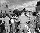 Gloria Richardson, head of the Cambridge Nonviolent Action Committee, pushes a National Guardsman's bayonet aside in July 1963 as she moves among a crowd of demonstrators in Cambridge, Md.