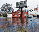 In this file photo, rainwater floods the intersection of Overbrook Road and Lombardy Street in North Side. About one-third of Richmond's storm drainage is tied into its sewer system, mostly in the East End, North Side and Downtown.