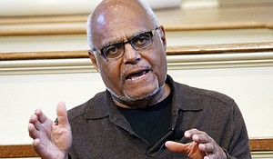 """In this Feb. 5, 2014 file photo shows Robert """"Bob"""" Moses, a director of the Mississippi Summer Project and organizer for the Student Non-Violent Coordinating Committee (SNCC) answers questions about Freedom Summer in 1964 during a national youth summit hosted by the Smithsonian's National Museum of American History, at the Old Capitol Museum in Jackson, Miss. Moses, a civil rights activist who endured beatings and jail while leading Black voter registration drives in the American South during the 1960s and later helped improve minority education in math, died Sunday, July 25, 2021, in Hollywood, Fla. He was 86."""