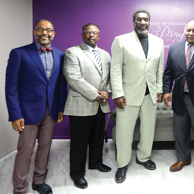 Faith leaders and football/Virginia Union University football team chaplain, the Rev. Joe Ellison, right, gathers with honorees at the 4th Annual Washington Football Team/RVA Faith Leaders Luncheon on Monday at New Kingdom Christian Ministries on Dill Avenue in Highland Park. The luncheon was co-hosted by Rev. Ellison and the church's senior pastor, Dr. Christopher Moore, left, to honor four Black College Football Hall of Famers. They are, beginning second from left, Virginia Union University Athletic Director Joe Taylor; former Washington Football Team quarterback and Super Bowl MVP Doug Williams, who is now special adviser to the WFT president; Willie E. Lanier, former NFL Kansas City Chiefs player and Pro Football Hall of Famer whose stellar football career started at Maggie L. Walker High School in Richmond; and Coach Willard Bailey, who coached four Virginia teams during an illustrious career at VUU, Norfolk State University, the former St. Paul's College and Virginia University of Lynchburg. Coach Bailey is the newest inductee in the Black College Football Hall of Fame; he was inducted in June. Joining the group also is the WFT Senior Team Chaplain Bishop Brett Fuller, second from right.