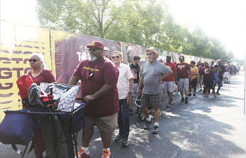 Welcoming the burgundy and gold/There's no doubt that the Washington Football Team has real diehard fans in Richmond. After a year's hiatus because of COVID-19, the NFL team received a big welcome back to its Richmond training camp on Wednesday by fans who turned out in droves. A long line formed early at the entry gate of the Bon Secours Training Facility on West Leigh Street as people waited eagerly to see their favorite players go through practice.