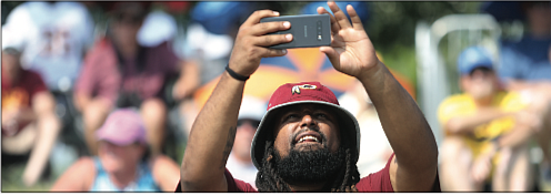 Welcoming the burgundy and gold/There's no doubt that the Washington Football Team has real diehard fans in Richmond. After a year's hiatus because of COVID-19, the NFL team received a big welcome back to its Richmond training camp on Wednesday by fans who turned out in droves.  Many wore the team colors of burgundy and gold. A fan records the field action on his cell phone.
