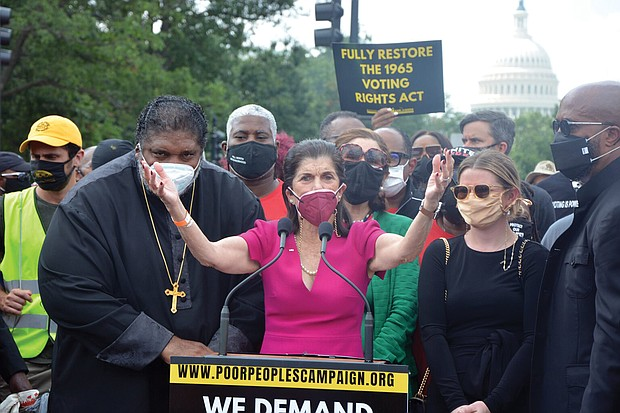 Luci Baines Johnson, daughter of former President Lyndon B. Johnson, urges the crowd to continue to fight for voting rights and social justice. Standing with her is the Rev. William J. Barber II, co-chair of the Poor People's Campaign.