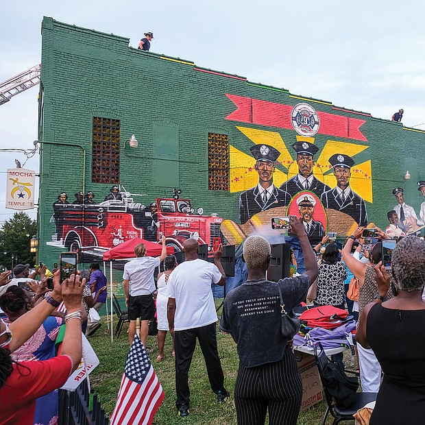 Scores of people turned out Aug. 6 for the official unveiling of the mural honoring the first Black firefighters hired by the City of Richmond. The 10 trailblazers were hired July 1, 1950, and were stationed at Engine Company No. 9 at 5th and Duval streets in Jackson Ward. The commemorative mural was done by local artists Sir James Thornhill, Jason Ford and Kevin Orlosky, and is situated on the side of the Mocha Temple No. 7 Shrine building at 613 N. 2nd St. in Jackson Ward. The unveiling was the kickoff of a weekend of activities sponsored by Engine Company #9 and Associates remembering and honoring the original firefighters.