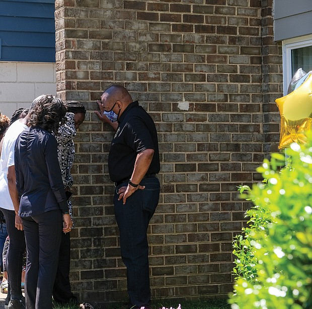 Police Chief Gerald Smith consoles the mother of one of the victims injured in gun violence April 27 at the Belt Atlantic Apartments in South Side. Sharnez Hill, 30, and her 3-month-old daughter were killed in the shooting and three others, ages 29, 15 and 11, were wounded. Chief Smith marched with scores of people attending a rally sponsored by Men in Action on May 1 calling for an end to the violence. The group marched from George Wythe High School to the apartment complex, where Chief Smith tried to comfort the mother.