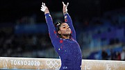 Vancouver's Jordan Chiles ends her balance beam routine during the women's artistic gymnastic qualifications at the 2020 Summer Olympics. Chiles won a silver medal for the United Sates in the women's team final, taking her place on the team after another favorite gymnast Simone Biles withdrew.  (AP photo)