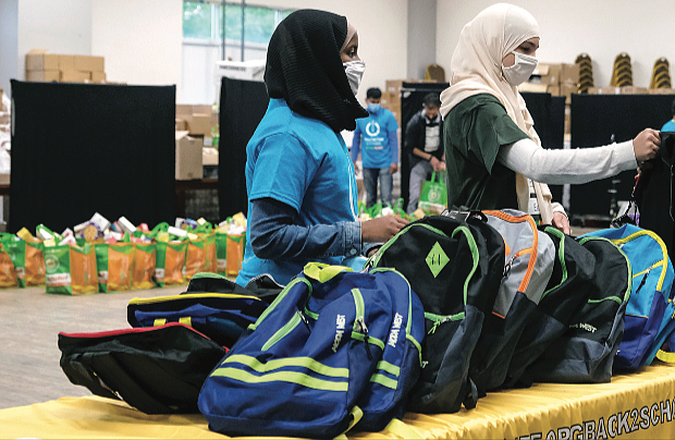 When the pencils, paper and notebooks come out, you know it's time for school. Fosio Issack, left, and Jennah Elganainy, both 15, volunteer to help distribute backpacks filled with school supplies on a recent Saturday at ICNA Relief's Back2School program. ICNA Relief is a national domestic relief organization that is part of the Islamic Circle of North America. The backpacks were distributed to children of all faiths and backgrounds in conjunction with Henrico County Public Schools. It was part of a national effort by the organization to equip 45,000 students with the essentials they need to succeed in the classrooms. The volunteer effort took place at the Islamic Center of Henrico/Al Falah on Impala Drive in the county. It was also the organization's food distribution day. Volunteers packed bags of nutritious goods to be distributed as well.