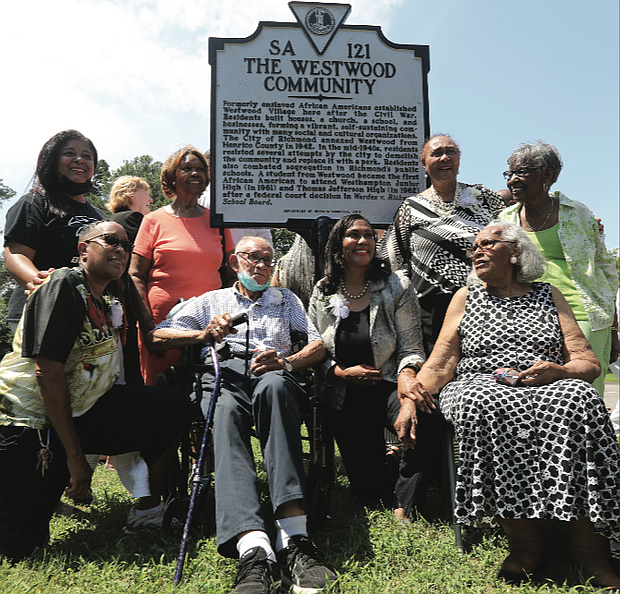Current and former residents of Westwood celebrate last Sunday a new state historical marker honoring the community in Richmond's West End that was started by formerly enslaved people following the Civil War. Location of marker: Willow Lawn Drive and Dunbar Street.  Residents built homes, a church, a school and businesses, as well as social and cultural organizations in the community that originally was a part of Henrico County. It was annexed to Richmond in 1942 and residents later successfully fought attempts by city officials to demolish the community and replace it with a public park. Westwood Baptist Church remains the most prominent landmark. Kathleen Hopkins Valentine, 93, seated at right, is the oldest resident living in Westwood. She said she and her family moved when she was 4 from Philadelphia to what was then called Westwood Village. Others pictured here are, from left, Kelly Johnson Crowder, whose mother, Jane Cooper Johnson, integrated Westhampton Junior High and Thomas Jefferson High School in the early 1960s; Charlene Hopkins, kneeling, and Frances Bush Jones, both cousins of tennis great Arthur Ashe Jr., whose grandparents lived in Westwood; Warrick Taylor, a former Westwood resident; Norfolk State University professor Dr. Colita Nichols Fairfax, immediate past chair of the Virginia Board of Historic Resources, kneeling, and her mother, Brenda Dabney Nichols, who was born and raised in Westwood; and Lennie Anderson Thornton, a former Westwood resident. The Friends of Westwood Playground paid for the marker.