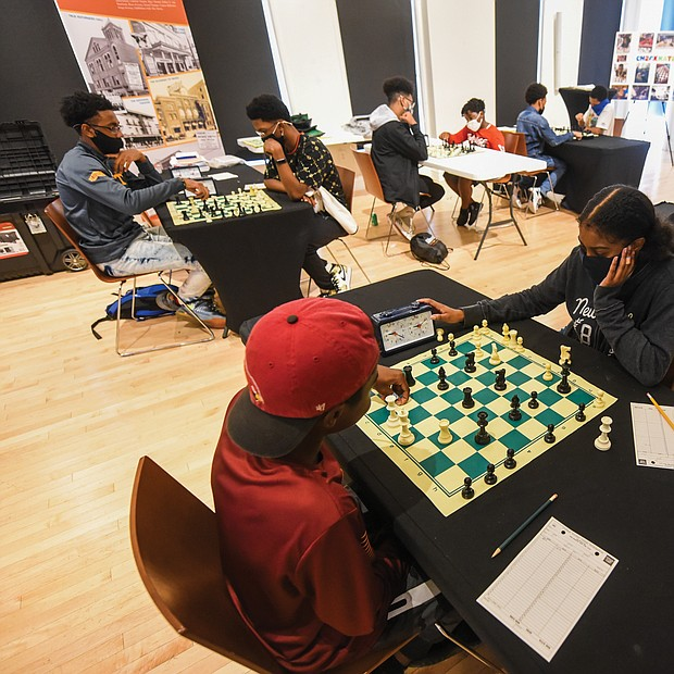 Checkmate! It was a race against the clock – and each other – during the Bright Minds RVA Chess Tournament, where a room full of area students matched wits last Friday, Aug. 27, at the Black History Museum and Cultural Center of Virginia. The tournament was the culmination of two weeks of classes taught by Fleming E. Samuels, a retired Richmond Public Schools administrator, and Dr. Theodore Andrews of Hampton University in a pilot program set up by the Bernice E. Travers Foundation. The inspiring group of 13- to 16-year-olds showed off the skills they learned during the tournament in which 14 students participated. Bottom photo, Binford Middle School student Jacory Oliver-Ray, 13, contemplates his next move, while, below, Franklin Military Academy student Ptah Ahmed, 13, left, faces off against Denzel Johnson, 14. Clinching the top three spots and prizes were Denzel Johnson; Jonathan Keel, 15, a student at Richmond Community High School; and Ptah Ahmed. (photo by Clement Britt)