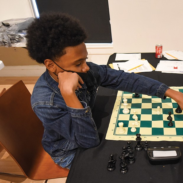 Checkmate! It was a race against the clock – and each other – during the Bright Minds RVA Chess Tournament, where a room full of area students matched wits last Friday, Aug. 27, at the Black History Museum and Cultural Center of Virginia. The tournament was the culmination of two weeks of classes taught by Fleming E. Samuels, a retired Richmond Public Schools administrator, and Dr. Theodore Andrews of Hampton University in a pilot program set up by the Bernice E. Travers Foundation. The inspiring group of 13- to 16-year-olds showed off the skills they learned during the tournament in which 14 students participated. Franklin Military Academy student Ptah Ahmed, 13, left, faces off against Denzel Johnson, 14. Clinching the top three spots and prizes were Denzel Johnson; Jonathan Keel, 15, a student at Richmond Community High School; and Ptah Ahmed. (photo by Clement Britt)