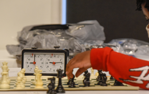 Checkmate! It was a race against the clock – and each other – during the Bright Minds RVA Chess Tournament, where a room full of area students matched wits last Friday, Aug. 27, at the Black History Museum and Cultural Center of Virginia. The tournament was the culmination of two weeks of classes taught by Fleming E. Samuels, a retired Richmond Public Schools administrator, and Dr. Theodore Andrews of Hampton University in a pilot program set up by the Bernice E. Travers Foundation. The inspiring group of 13- to 16-year-olds showed off the skills they learned during the tournament in which 14 students participated. Binford Middle School student Jacory Oliver-Ray, 13, contemplates his next move. Clinching the top three spots and prizes were Denzel Johnson; Jonathan Keel, 15, a student at Richmond Community High School; and Ptah Ahmed. (photo by Clement Britt)