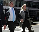 Investor John Wilson, left, arrives at federal court in Boston with his wife, Leslie, to face charges in a nationwide college admissions bribery scandal.