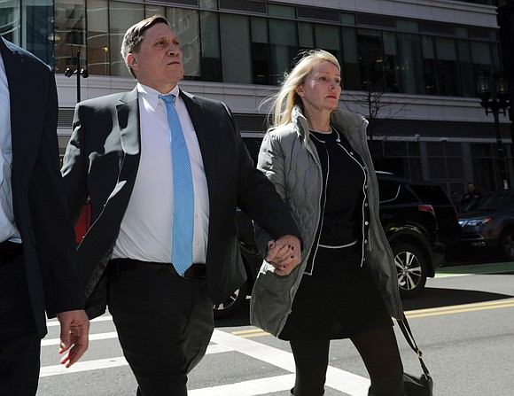 The first full trial in the college admissions bribery scandal opened Monday with defense attorneys seeking to portray the two ...