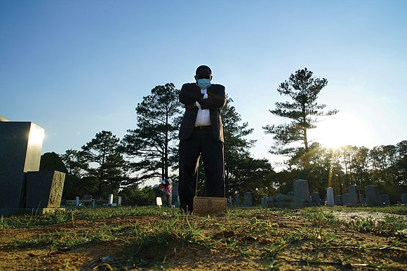 When the last mourners departed and funeral director Shawn Troy was left among the headstones, he wept alone.