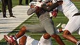 Virginia Union University wide receiver Jaiden Reavis is taken down last Saturday by two players from Valdosta State University, Jaylen Jackson on the ground and Ivory Durham.
