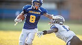 Armstrong High School's Kile Artis gets past the John Marshall High defense to score a touchdown in last Friday's game. The Armstrong Wildcats wore jerseys bearing the colors and mascot name – the Jaguars – of the former Armstrong-Kennedy High School Complex.