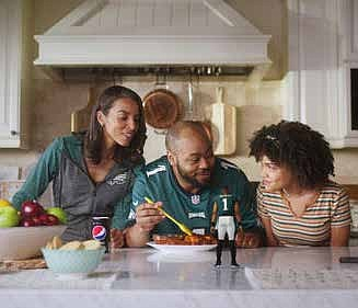 """Pepsi launched its """"Made for Eagles Watching"""" campaign with digital content featuring a virtual Jalen Hurts helping one family take their pre-game food prep up a notch, just in time for the coin toss. PRNewsFoto/PepsiCo"""