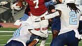 Virginia Union University running back Jada Byers is swarmed by Virginia University of Lynchburg's defense last Saturday at Hovey Stadium. The freshman from New Jersey rushed for a total of 201 yards and two touchdowns during the game.