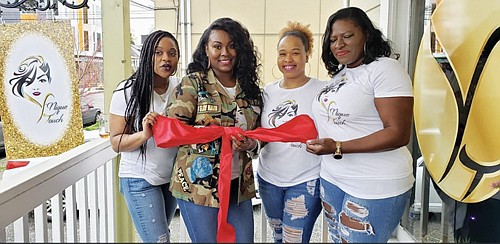 Y'Nique McAllister Wright at the grand opening of her Y'Nique Touch Salon with her best friends who helped plan the festivities. Pictured (from left) are DeSaree Hall, Wright, Celeste Tillman and Manerva Hart.