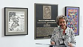 Mary DePillars, widow of VCUarts dean Dr. Murry N. DePillars, speaks at the dedication ceremony Sept. 30 renaming the arts building at 1000 W. Broad St. in honor of her late husband. A plaque honoring Dr. DePillars, along with copies of two of his art pieces, are behind her in the building's lobby.