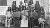 Chiricahua Apache boys and girls pose outdoors at the Carlisle Indian Industrial School in Carlisle, Penn., after their arrival from Fort Marion, Fla., in November 1886.
