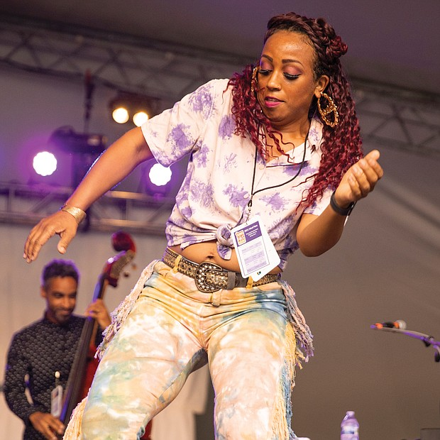 Tap dancer and singer Brinae Ali dances on Saturday afternoon on the Altria Stage to the music of the Baltimore jazz group Dizzy Spellz.