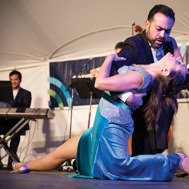 Leonardo Sardella and Mariana Parma dance an Argentine tango on the Community Foundation Stage in front of a grateful audience.