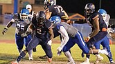 Virginia State University running back Kimo Clarke takes on Elizabeth City State University defensive players during last Saturday's 35-7 victory over the Vikings.