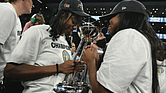 The Chicago Sky's Diamond DeShields, left, and Lexie Brown celebrate with the championship trophy Sunday after defeating the Phoenix Mercury 80-74 in Game 4 of the WNBA Finals in Chicago.
