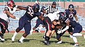 The Virginia State University defense scrambles to keep the Bowie State University ball carrier from making much headway in last Saturday's game. VSU ultimately lost to the perennial powerhouse 51-44.