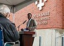 James Broadous II helps usher in a new permanent home for De La Salle North Catholic High School during a ceremony celebrating the completion of a renovation and construction at the former St. Charles Elementary School site, next door to St Charles Church near Northeast 42nd and Killingsworth. Broadous serves as the school's vice principal for student life and boys basketball coach.