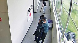 Surveillance video from Parkrose High School shows Parkrose Football Coach Keanon Lowe holding a student in an embrace after disarming him