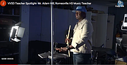 Romeoville High School Music Teacher Adam Hill discusses drum techniques with students during a virtual lesson.