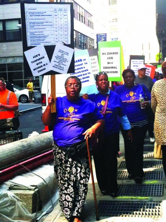 """""""We charge ACS with criminal behavior."""" On Monday, a group of protesters picketed on Fulton..."""